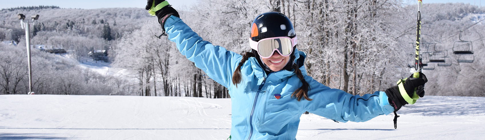 female-skier-excited-about-snow