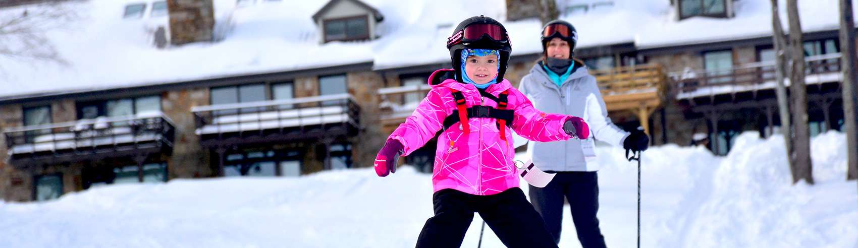 little-girl-skiiing-with-mom-in-bgd