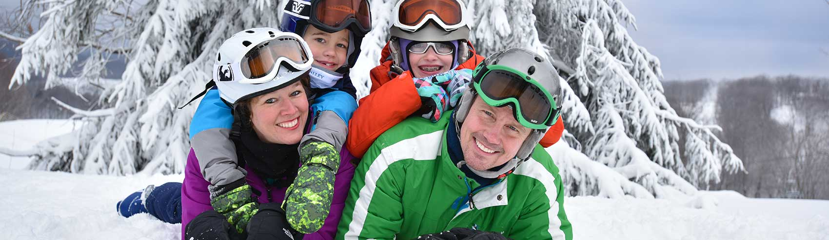 Family making memories in the snow at Hidden Valley