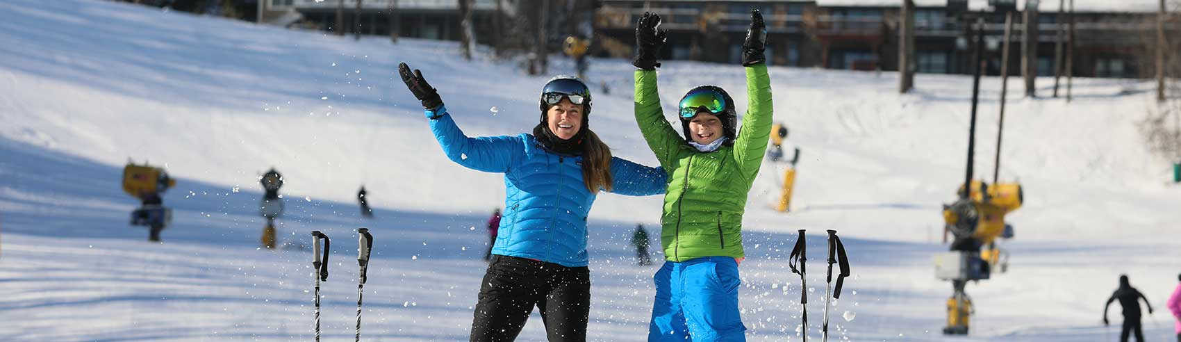 Mom and kid on the slopes