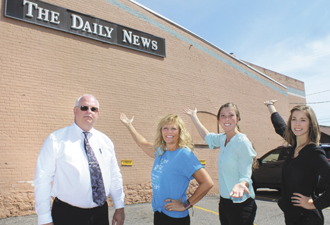 IRON MOUNTAIN DAILY News Publisher Corky DeRoeck, left, shows off the site for the next Power of Words project mural with artist Mia Tavonatti, DDA Director Paula Craven and DDA Chairwoman Megan Blomquist. A crowdfunding effort has begun for the project. (Theresa Proudfit/Daily News photo)