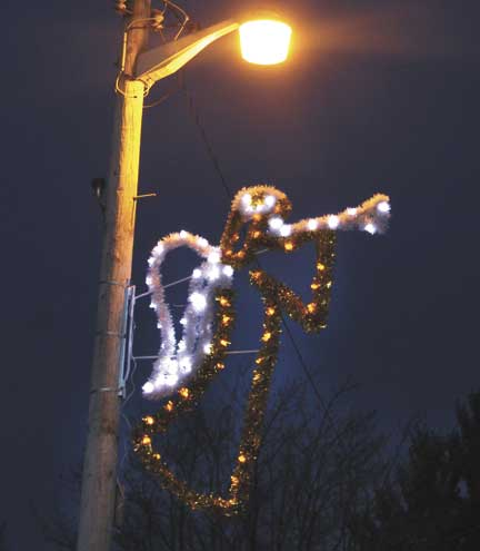 theresa proudfitdaily news photos the first three christmas decorations have gone up on light poles in quinnesec a part of a campaign to get decorations