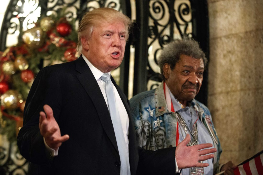 PRESIDENT-ELECT DONALD TRUMP, left, with boxing promoter Don King as he speaks to reporters at Mar-a-Lago on Wednesday in Palm Beach, Fla. (AP Photo/Evan Vucci)