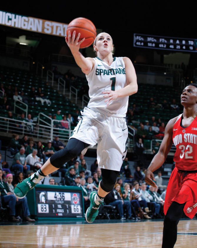 Michigan State's Tori Jankoska (1) goes up for a layup against Ohio State's Shayla Cooper during the second half of an NCAA college basketball game, Tuesday, Jan. 10, 2017, in East Lansing, Mich. Jankoska had 42 points, setting both single-game and career scoring records for Michigan State in the team's 94-75 win. (AP Photo/Al Goldis)