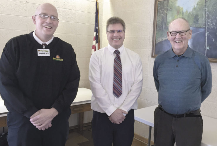 Pictured from left at the recent Golden K meeting are One District Manager Robert DeLongchamp, Super One Manager Jon Revier and Golden K February Chairman and Program Chairman John Aune.