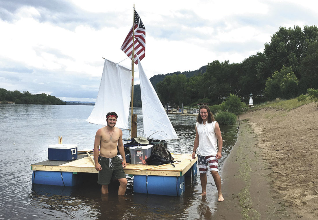 COUSINS NICK, LEFT, and Gregory Smith made their first attempt at sailing a home made wooden raft on the Mississippi River last summer but ran into some high water and had to cut their trip short. The duo plans to reattempt the large feat and run the entire Wisconsin border of the Mississippi this coming summer.