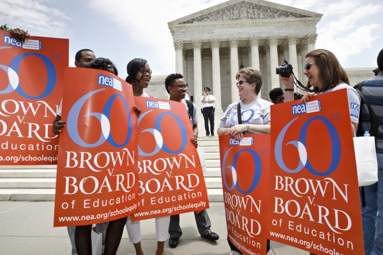 """AP Photo  NATIONAL EDUCATION ASSOCIATION staff members from Washington joining students, parents and educators at a May 13, 2014, rally at the Supreme Court in Washington on the 60th anniversary Brown v. Board of Education decision that struck down """"separate but equal"""" laws that kept schools segregated."""