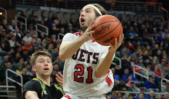 MHSAA Second Half Photo  North Central's Bobby Kleiman drives to the basket during Saturday's Class D Final. (Middle) The Jets' Marcus Krachinski tries to block a shot by Buckley's Denver Cade.