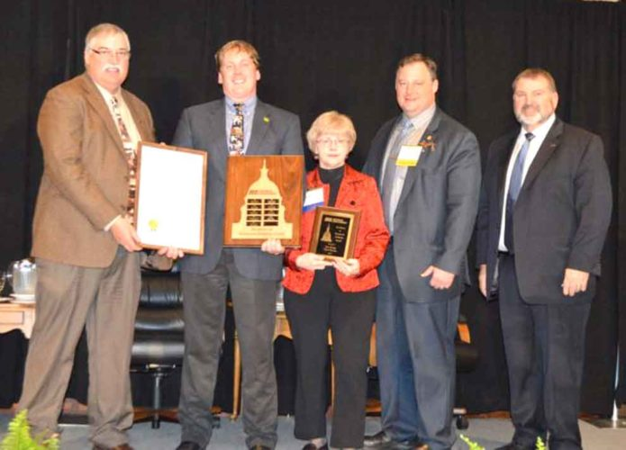 THE IRON RANGE Farm Bureau recently received an award from the state organization. Shown here, from left, are Dave Bahrman, District 11 director of the Michigan Farm Bureau; Ed McBroom, former state representative and Iron Range Farm Bureau member; Marsha Wainio, state promotion and education committee member and Iron Range Farm Bureau member; state Rep. Scott Dianda, D-Calumet; and Carl Bednarski, Michigan Farm Bureau president.