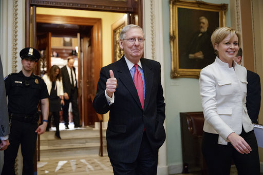 Senate Majority Leader Mitch McConnell of Ky. signals a thumbs-up as he leaves the Senate chamber on Capitol Hill in Washington, Thursday, April 6, 2017, after he led the GOP majority to change Senate rules and lower the vote threshold for Supreme Court nominees from 60 votes to a simple majority in order to advance Neil Gorsuch to a confirmation vote. (AP Photo)