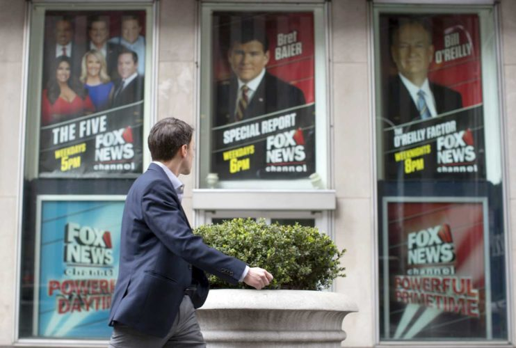 "AP Photo/Mary Altaffer  A pedestrian walks past the News Corp. headquarters building in New York displaying posters featuring Fox News Channel personalities including Bill O'Reilly, right, on Wednesday. O'Reilly has lost his job at Fox News Channel following reports that five women had been paid millions of dollars to keep quiet about harassment allegations. 21st Century Fox issued a statement Wednesday that ""after a thorough and careful review of the allegations, the company and Bill O'Reilly have agreed that Bill O'Reilly will not be returning to the Fox News Channel."
