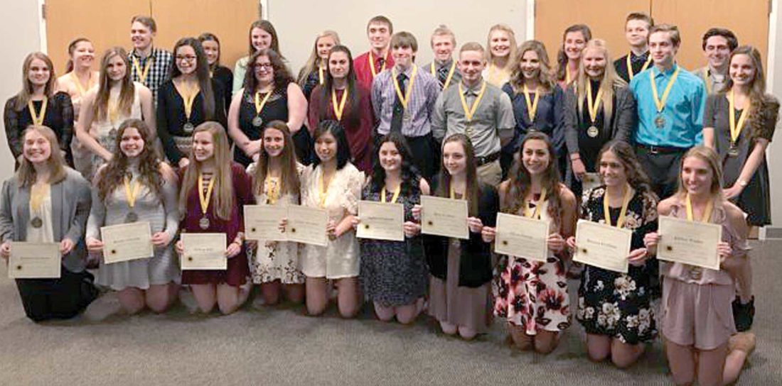The Iron Mountain High School Honor Society held its induction ceremony April 5 in the high school auditorium. The guest speaker for the ceremony was Iron Mountain High School graduate and current MTU student Adam Weber. Senior members Elizabeth Brown, Brooke Fornetti, Grace Hansen and Megan Pope described the qualities students must possess to become honor society members. Antoinette DeMerse swore in new members, who then received their medals and certificates. Second-year members also were recognized. After the ceremony, members and guests enjoyed a catered dinner at the Izzo-Mariucci Center. Pictured are new members, from left, front row: Jovanna Erickson, Katelyn Charette, Bethany Fehr, Taylor Talerico, Lillian VanLoon, Sophia Schinderle, Riley St. John, Olivia Berutti, Brianna Hoffman and Jordan Weslin; middle row: Taylor Paupore, Kylie Butterfield, Lydia Decker, Lauren Czerwan, Sophia Berutti, Michael Kulas, William McCormick, Mary Hanson, Marissa Schilling, Evan Geronimi and Lily Mercer; back row: Reighan Johnson, Scott Vincent, Lindsay Morel, Angela Carollo, Allison Gregg, Ben Diercks, Caleb Plumley, Claire Czernek, Miranda Julian, Isaac Aderman and Zach Celello.