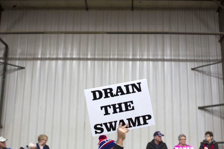 SUPPORTERS OF THEN-Republican presidential candidate Donald Trump hold signs during a campaign rally in October 2016 in Springfield, Ohio. (AP Photo/Evan Vucci, file)