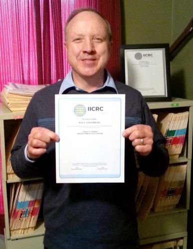 DALE STROMBERG OF Advanced Clean Care in Iron River shows his recent certification in water damage restoration. He received this credential after attending a seminar through the Institute of Inspection, Cleaning and Restoration.