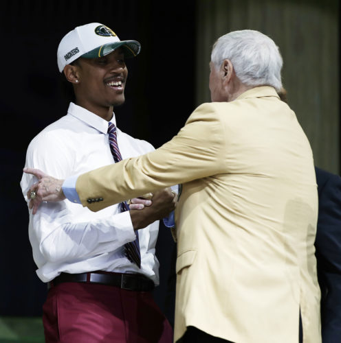 Washington's Kevin King, left, greets former Green Bay Packers' Jim Taylor after King was selected by Green Bay during the second round of the 2017 NFL football draft last Friday in Philadelphia. (AP Photo/Matt Rourke)