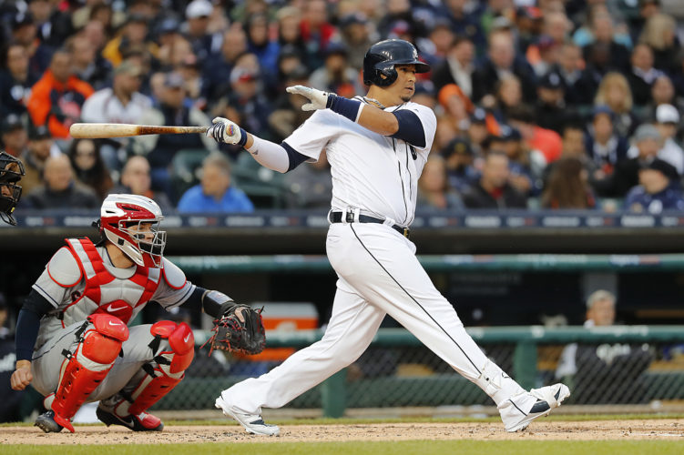 Detroit Tigers designated hitter Victor Martinez doubles against the Cleveland Indians in the second inning in Detroit on Monday. Nicholas Castellanos scored on the play. (AP Photo/Paul Sancya)