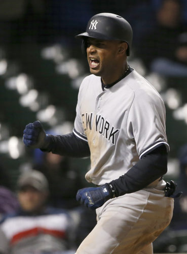 New York Yankees' Aaron Hicks reacts after scoring on a fielder's choice by Chicago Cubs shortstop Addison Russell during the 18th inning of an interleague game early Monday in Chicago. (AP Photo/Nam Y. Huh)