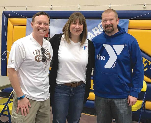 From left, Northern Lights YMCA Center Director Jonathan Ringel, Youth Coordinator Kelly Evosevich-Poupore and Membership and Marketing Director Ron Deuter welcomed more than 750 people to the annual Healthy Kids Day at Kingsford Middle School.