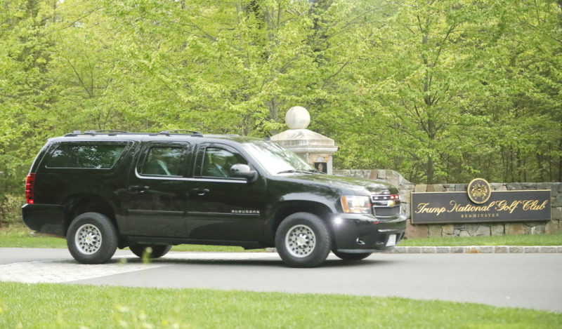 A MOTORCADE SUV vehicle transporting President Donald Trump leaves the Trump National Golf Club in Bedminster, N.J. (AP Photo/Pablo Martinez Monsivais, File)