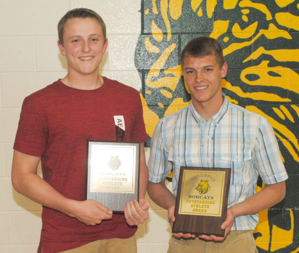 Nathan Krueger, left, and Jay Walstrom shared the David Wenzel Memorial Athlete of the Year honor during Florence High School's 48th annual awards ceremony Wednesday. (Burt Angeli/The Daily News)