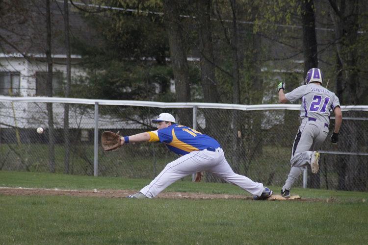 Niagara's Charlie Schaeffer reaches first base as Crivitz first baseman Brandon LaRuie stretches for the throw in M&O Conference play Thursday in Niagara, Wis. (Adam Niemi/The Daily News)