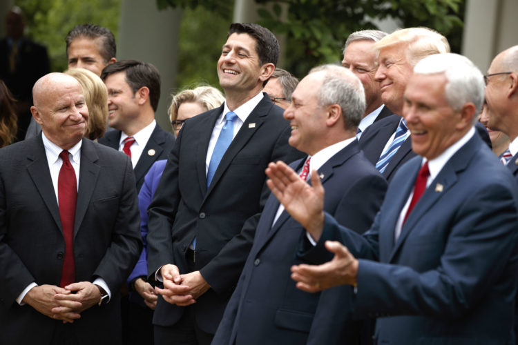 PRESIDENT DONALD TRUMP, accompanied by GOP House members, cheer for Speaker of the House Rep. Paul Ryan, R-Wis., after the House pushed through a health care bill, in the Rose Garden of the White House in Washington. Members of Congress looking to rewrite former President Barack Obama's Affordable Care Act have a unique perspective, since many of them are signed up for the health care it created. (AP Photo/Evan Vucci)