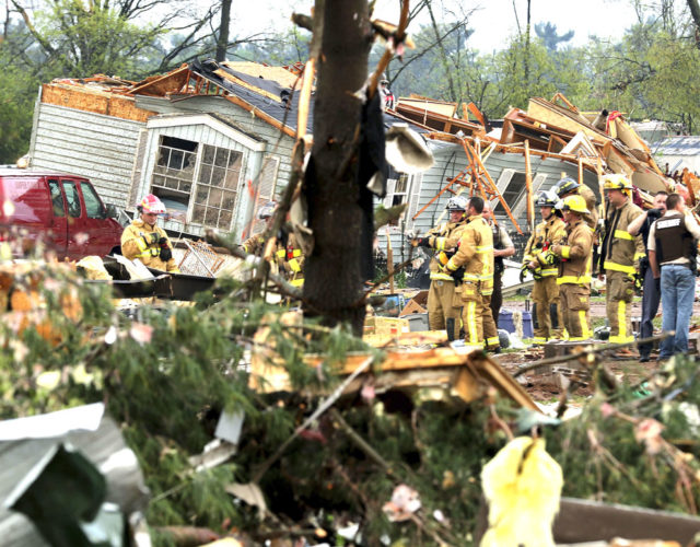 Firefighters work the site of the damage after a tornado ripped through Prairie Lake Estates trailer home park, just north of Chetek, Wis., Tuesday. The tornado swept into the mobile home park in western Wisconsin as a storm system also pounded parts of at least seven states from Texas to near the Canadian border with heavy rain, high winds and hail. (Dan Reiland/The Eau Claire Leader-Telegram photo)