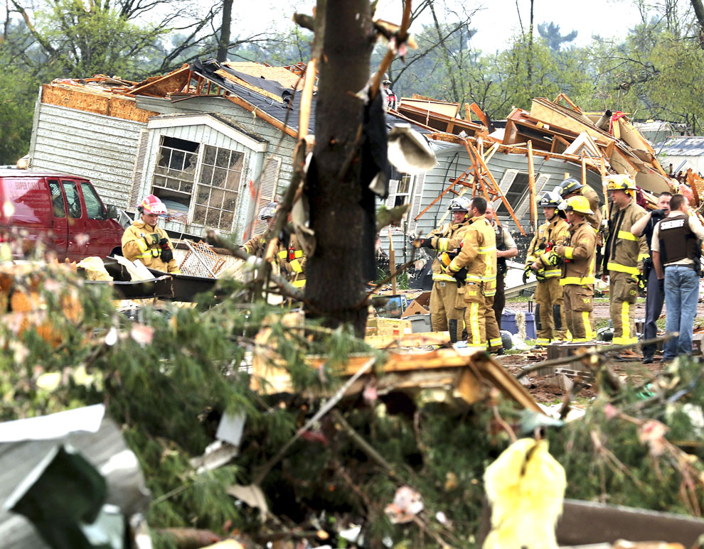 Firefighters Work The Site Of Damage After A Tornado Ripped Through Prairie Lake Estates Trailer