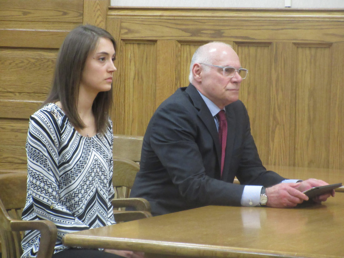 NICOLE VANDERLIN, LEFT, awaits sentencing in Dickinson County District Court on two counts of moving violation causing death from a 2016 double fatal traffic accident in Breitung Township. Also pictured is defense attorney Vincent Petrucelli. (Nikki Younk/Daily News photo)