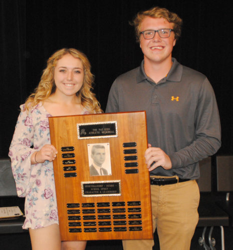 Burt Angeli/The Daily News Photo  Paige Fortner and Trent Juul received Iron Mountain High School's Pat Izzo Memorial during Wednesday's 57th annual Senior Awards Night program.