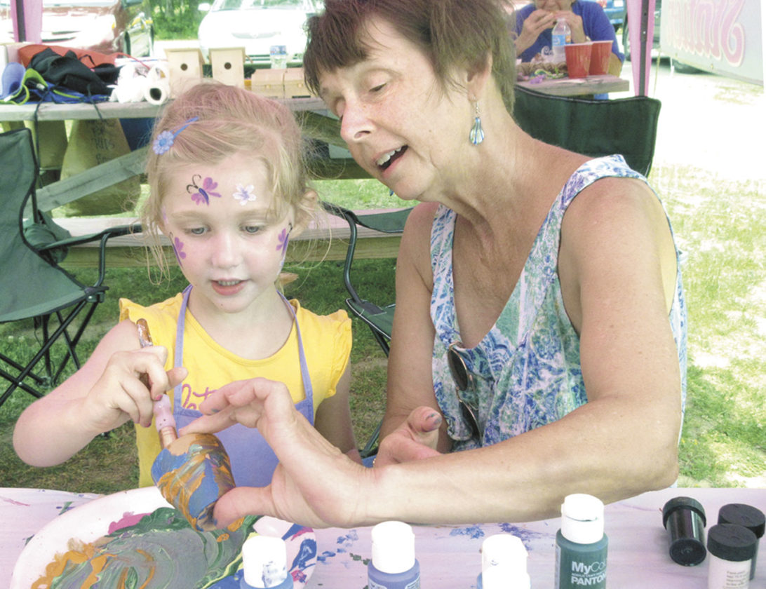 ALI FLEMING AND McKay Gagnon paint a flower pot at the Creation Station exhibit during Art For All in 2016 at Iron Mountain City Park. The 2017 event is Saturday. (Theresa Proudfit/Daily News photo)
