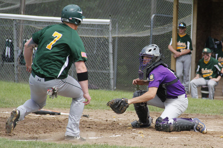 Niagara Legion catcher Joe Murvich, right, tags out Keweenaw County's Jake Thyes in the first game of a doubleheader on Sunday in Niagara, Wis. (Adam Niemi/The Daily News)