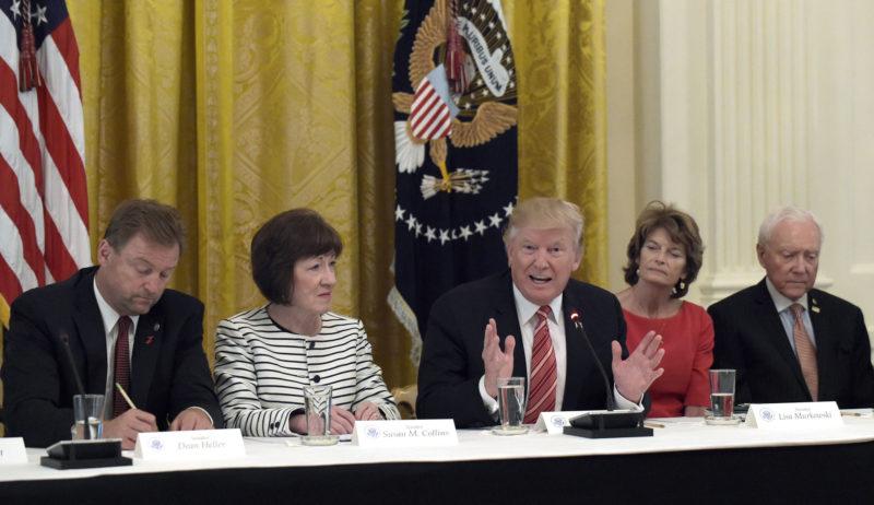 PRESIDENT DONALD TRUMP, center, meets Tuesday with Republican senators on health care at the White House in Washington. Seated with him, from left, are Sen. Dean Heller, R-Nev.; Sen. Susan Collins, R-Maine; Sen. Lisa Murkowski, R-Alaska; and Sen. Orrin Hatch, R-Utah. (AP Photo/Susan Walsh)