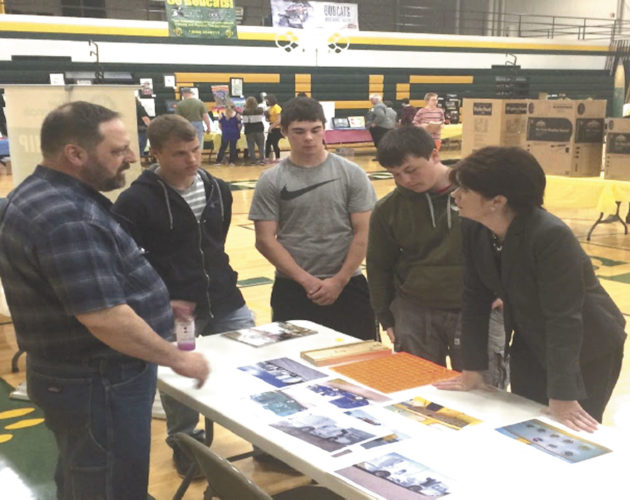 CHARLIE VANGINKLE OF Lodal Inc. goes over a project done in partnership with students from the Florence High School Fab Lab. VanGinkle, at left, is shown with students Jay Walstrom, Glenn Berry, Tommy Podnar and Wisconsin Lt. Gov. Rebecca Kleefisch.