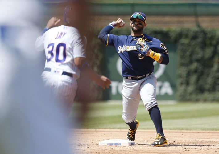 Milwaukee Brewers second baseman Jonathan Villa, right, throws to first after forcing out Chicago Cubs' Jon Jay at second during the third inning Thursday in Chicago. Kris Bryant was safe at first. (AP Photo/Nam Y. Huh)