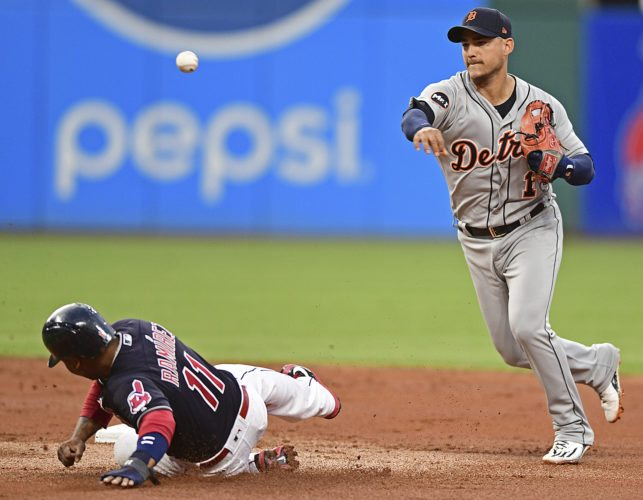 Detroit Tigers' Jose Iglesias, right, throws out Cleveland Indians' Jose Ramirez, left, at second base and Lonnie Chisenhall at first base in the second inning on Sunday in Cleveland. (AP Photo/David Dermer)