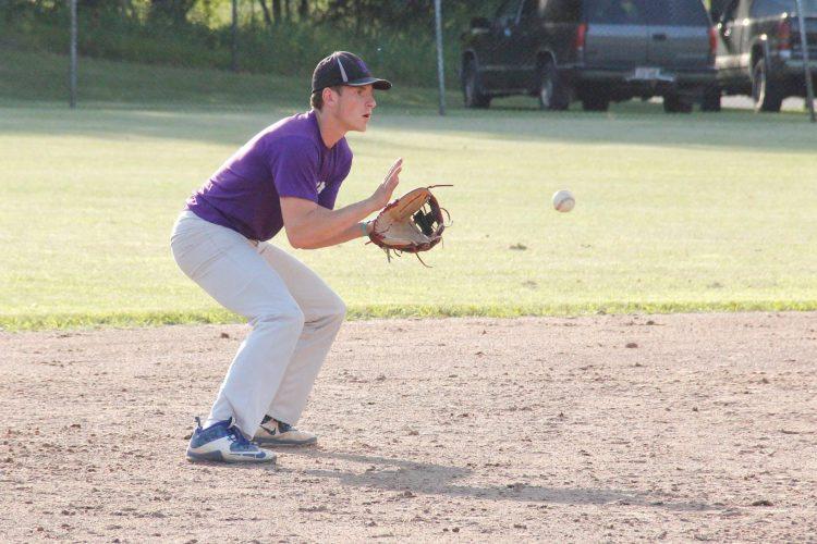 Niagara American Legion shortstop Kevin Evosevich gathers a ground ball against Escanaba on Monday in Niagara, Wis. (Adam Niemi/The Daily News)