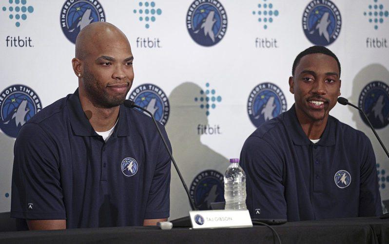 New Minnesota Timberwolves team members Taj Gibson, left, and Jeff Teague, right, sit together in Minneapolis on Monday. (Richard Tsong-Taatarii/Star Tribune via AP)