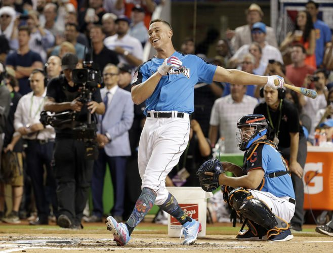New York Yankees' Aaron Judge smiles as he competes during the MLB baseball All-Star Home Run Derby on Monday in Miami. (AP Photo/Lynne Sladky)
