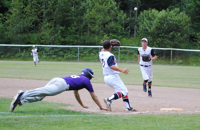 Niagara's Joe Murvich dives for the bag while Gladstone pitcher Owen Hanson takes a throw from first baseman Elliot Danhoff in Tuesday's American Legion baseball game at Memorial Park. (Burt Angeli/The Daily News)