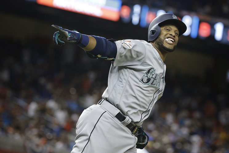 American League's Seattle Mariners Robinson Cano (22), rounds the bases after hitting a homerun in the tenth inning during the MLB All-Star Game on Tuesday in Miami. (AP Photo/Lynne Sladky)