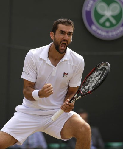 Marin Cilic, of Croatia, celebrates winning the third set against Luxembourg's Gilles Muller during their Men's Singles Quarterfinal Match on day nine at the Wimbledon Tennis Championships in London on Wednesday. (AP Photo/Alastair Grant)