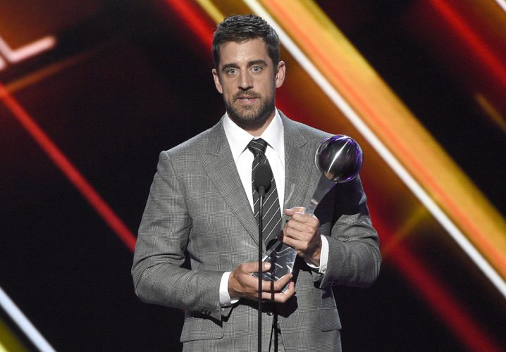 Aaron Rodgers, of the Green Bay Packers, accepts the award for best play at the ESPYS at the Microsoft Theater on Wednesday in Los Angeles. (Photo by Chris Pizzello/Invision/AP)