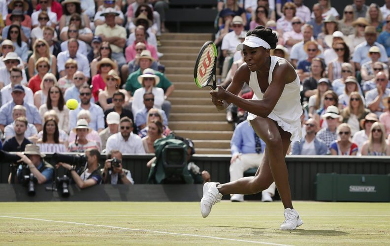 Venus Williams of the United States returns to Britain's Johanna Konta during their Women's Singles semifinal match on day nine at the Wimbledon Tennis Championships in London on Thursday. (AP Photo/Kirsty Wigglesworth)
