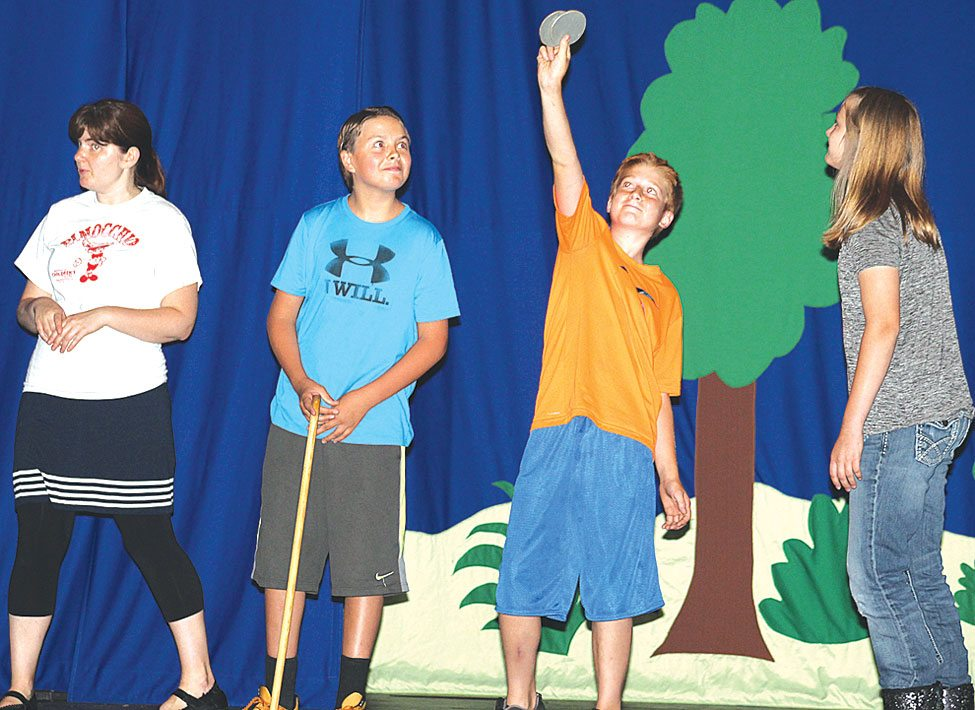 """DURING LAST YEAR'S production of """"Pinocchio"""" director Kate Brauneis, left, works with Conn Davis, Villainous Fox; William Fairchild, Pinocchio; and Anna Lundholm, the mischievous Cat. The Missoula Children's Theatre is back in town Monday holding auditions for """"Aladdin,"""" with two performances on July 22."""