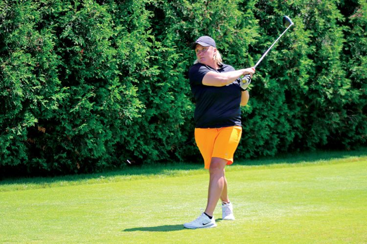 Karla McCutcheon of Marquette, in the championship flight, drives during the Upper Peninsula Ladies Golf Association annual tournament at the Marquette Golf Club Heritage course Monday afternoon. (Rachel Oakley/The Mining Journal)