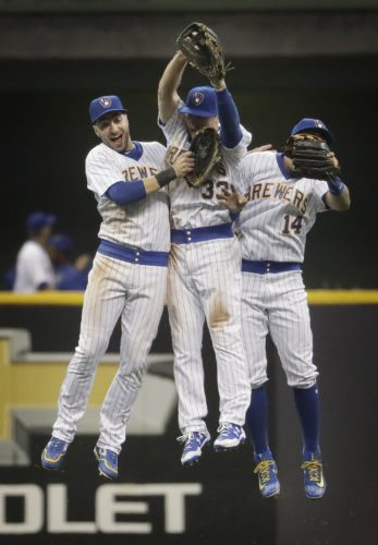 Milwaukee's Ryan Braun, left, and the Brewers find themselves leading the NL Central just ahead of the July 31 trade deadline. The Brewers' surprise success has them weighing options for a playoff push. (AP Photo/Morry Gash)