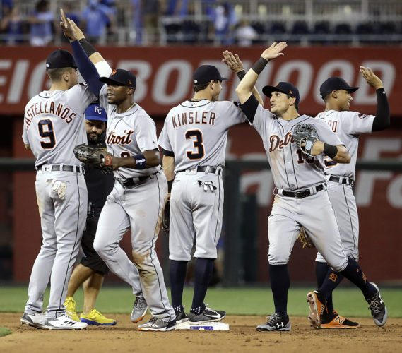 Detroit Tigers celebrate after a 9-3 win over the Kansas City Royals in a baseball game Tuesday in Kansas City, Mo. (AP Photo/Charlie Riedel)