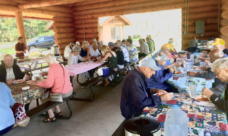 Golden K members enjoy an afternoon picnic at theCity Park pavilion in IronMountain.