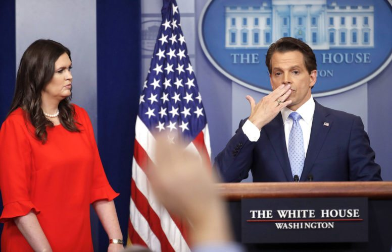 SARAH HUCKABEE SANDERS, left, who has been named White House press secretary, watches as incoming White House communications director Anthony Scaramucci blows a kiss after answering questions during the press briefing Friday at the White House. (AP Photo/Pablo Martinez Monsivais)